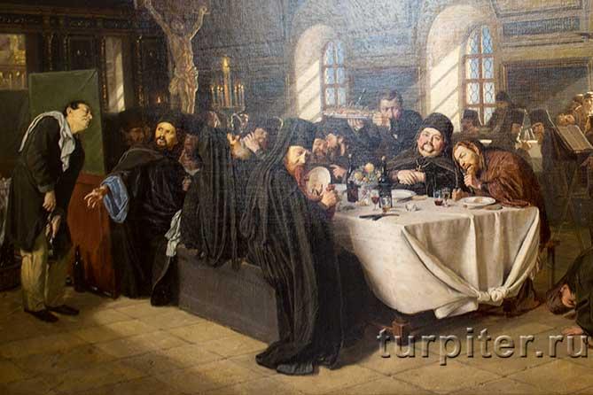 служители церкви пьют вино и едят